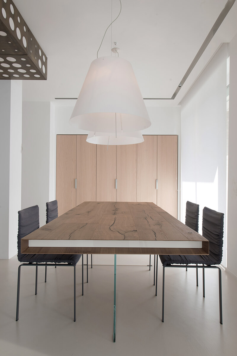 table dining room with woven chairs